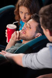 Talking at phone in cinema. Stock Photography