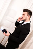 Talking by phone before going on travel Stock Photography