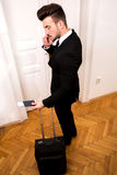 Talking by phone before going on travel Stock Image