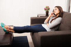 Talking on the phone at home Stock Photos