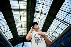 Talking on the phone. Man talking on the phone under the dome stationn Royalty Free Stock Images