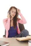 Talking phone teen study Stock Photo