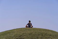 Talking on phone. Teenage girl talking on phone, sitting on the grass Royalty Free Stock Photo