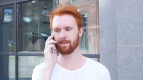 Talking on Phone, w/ Camera Moving Around Young Man, Outdoor, Red Hairs. Creative designer , businessman stock video