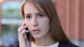 Talking on Phone, Woman Discussing Work on Smartphone. High quality Royalty Free Stock Photo