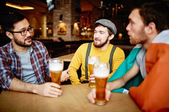 Talking in pub Royalty Free Stock Photo