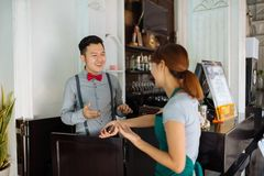 Talking restaurant staff Stock Photography