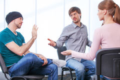 Talking and sitting Stock Image