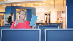 Talking skype in the airport Stock Photos