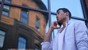 Talking on Smartphone, Standing Young Black Male Designer. Creative designer , businessman stock video