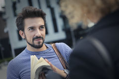 Talking on the street. Man is talking on the street with a woman Royalty Free Stock Photos