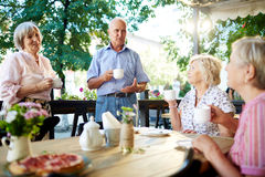 Talking by tea Stock Images