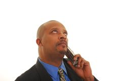 Talking on telephone. African American man talking on telephone isolated on white Stock Photography