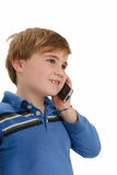 Talking on Telephone. Child smiling as he listens on cell phone, isolated on white Stock Images