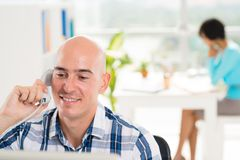 Talking on the telephone. Handsome smiling businessman talking on the telephone Royalty Free Stock Photos