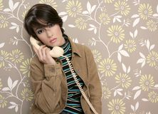Talking telephone retro woman on vintage wallpaper Royalty Free Stock Images