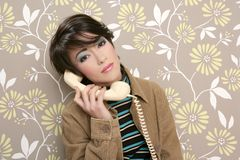 Talking telephone retro woman on vintage wallpaper Stock Photos
