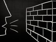 Talking to a brick wall royalty free stock image