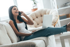 Talking to a friend at home. Royalty Free Stock Photography