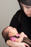 Talking to Her Newborn Baby Royalty Free Stock Photos