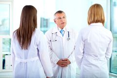 Talking to nurses Royalty Free Stock Photo
