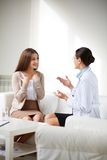Talking to patient Stock Images