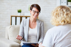Talking to patient. Successful psychologist talking to her patient Royalty Free Stock Image