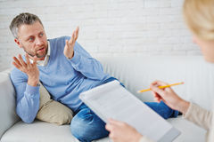 Talking to psychologist Stock Image