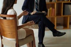 Talking to psychologist stock photo