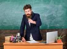 Talking to students or pupils. Teacher bearded man tell interesting story. Teacher interesting interlocutor best friend. Teacher charismatic hipster stand near stock photo