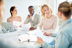 Talking to subordinate. Successful female having talk to one of her subordinates at meeting in office Stock Photos