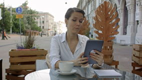 Talking to sweetheart. Young attractive lady talking per skype on new tablet. stock video footage