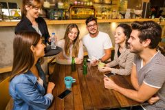 Talking to the waitress stock photography