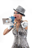 Talking to you. Young woman holding a megaphone and pointing her finger to the camera Stock Photos