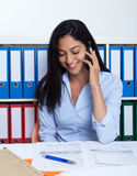 Talking turkish businesswoman with phone at office royalty free stock photo