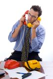 Talking on two telephones Royalty Free Stock Photos