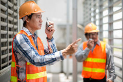 Talking on walkie-talkie Royalty Free Stock Image