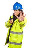Talking with a walkie talkie and orders to stop Stock Photo