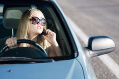 Talking woman. Woman talking in the car by mobile Royalty Free Stock Photography