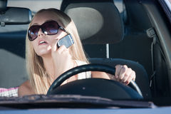 Talking woman. Woman talking in the car by mobile Stock Image