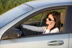 Talking woman. Woman talking in the car by mobile Stock Photography