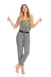 Talking Young Woman In Jumpsuit Is Showing Thumbs Up Stock Photography