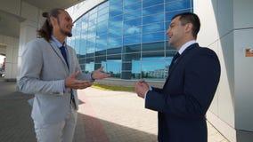 Talks about business development stock video footage