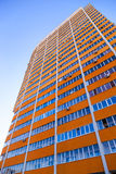 Tall apartment building over blue sky background Royalty Free Stock Images