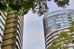 Tall Apartment Buildings at Olympic Park, Sydney, Australia. Commercial suites in new apartment blocks. Looking up at a modern high-rise apartment houses Royalty Free Stock Photo