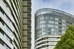 Tall Apartment Buildings at Olympic Park, Sydney, Australia. Commercial suites in new apartment blocks. Looking up at a modern high-rise apartment houses Royalty Free Stock Photos