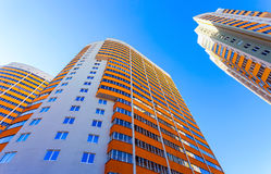 Tall apartment buildings over blue sky Royalty Free Stock Images