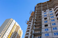 Tall apartment buildings over blue sky Royalty Free Stock Image