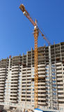 Tall apartment buildings under construction with crane against a Royalty Free Stock Photography