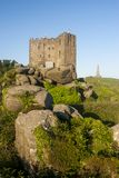 The tall Basset monument and Carn brea castle. A beautiful sunny shot of The basset monument and Carn brea castle on top of Carn brea hill, Cornwall, England Royalty Free Stock Photography